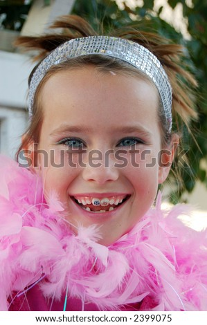 Cute girl with pink feather boa around her neck. - stock photo