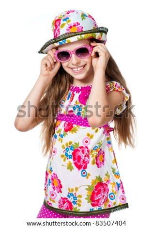 cute girl with pink sunglasses isolated on white background - stock photo