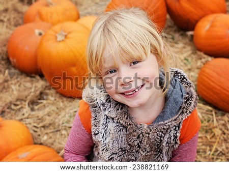 Cute girl with pumpkins