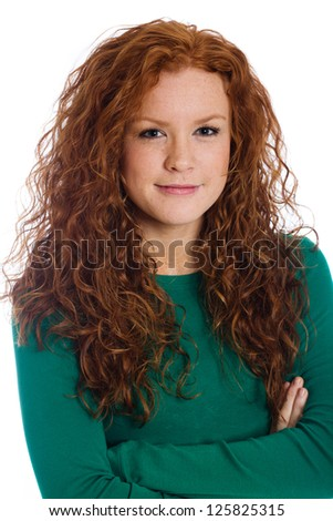 Cute girl with red hair and crossed arms. - stock photo