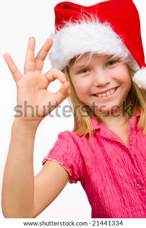 Cute girl with red hat gesturing victory sign with fingers - stock photo