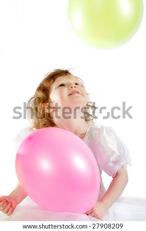 Cute girl with the air balloons - stock photo