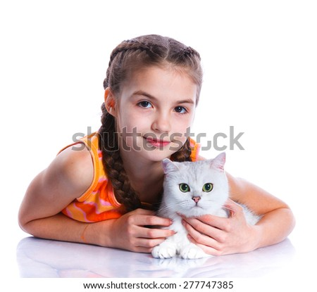 Cute girl with white cat smiling at camera on isolated white background - stock photo