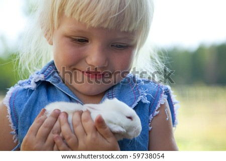 cute girl with white rabbit - stock photo