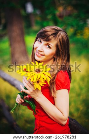cute girl with yellow flowers - stock photo
