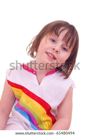 Cute girl (4Yr) with colorful rainbow dress, against a white background - stock photo
