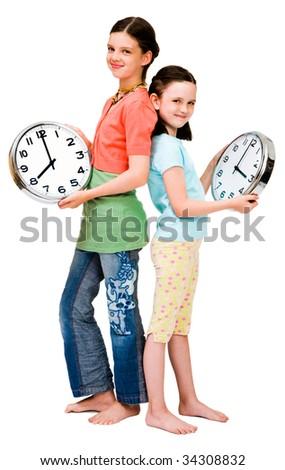 Cute girls holding clocks isolated over white - stock photo
