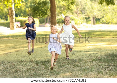 Cute girls in park on sunny day