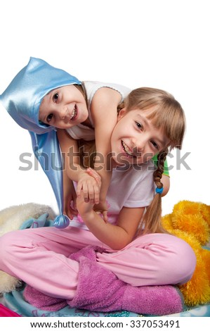Cute girls in pink pajamas smiling  isolated on white - stock photo