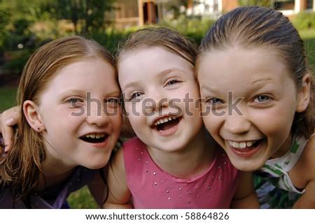 Cute girls play in the garden. - stock photo