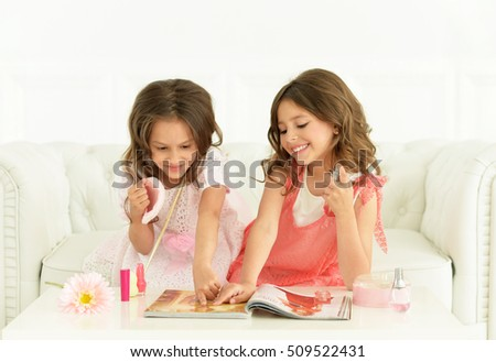 Cute   girls with magazine