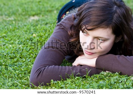 Cute green eyed woman on the grass