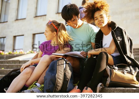 cute group of teenages at the building of university with books huggings, diversity nations - stock photo