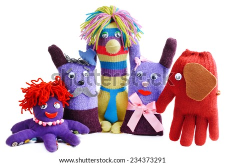 Cute handmade toys of gloves isolated on white - stock photo