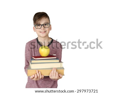 Cute handsome boy in glasses holds stack of books with apple on top isolated on white background with copy space for text - stock photo