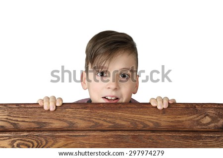 Cute handsome boy look over wooden fence isolated on white background - stock photo