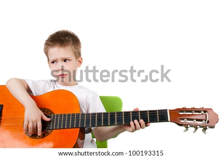 cute handsome displeased little boy with the guitar