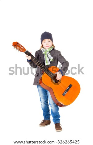 cute handsome little boy with the guitar - stock photo