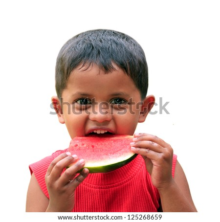 Cute, handsome little indian boy eating fresh watermelon with happy smile on his face showing the satisfaction of eating the summertime nutritious fruit - stock photo