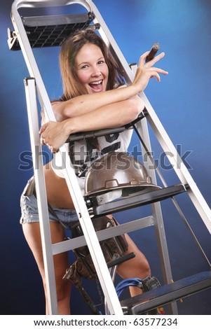 Cute handyman with cigar on a ladder - stock photo