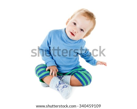 Cute happy baby blonde in a blue sweater smiling portrait, isolated on a white background - stock photo