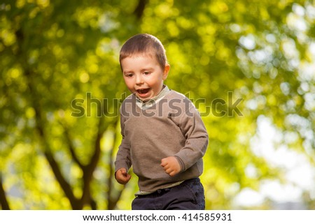 Cute  happy baby boy walking in summer park . Outdoor  portrait - stock photo