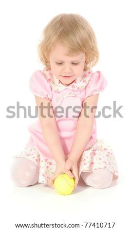 Cute happy baby girl with a tennis ball. - stock photo