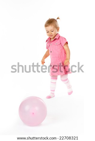 Cute happy baby girl with baloon