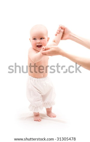 Cute happy baby girl with mother hands on white background