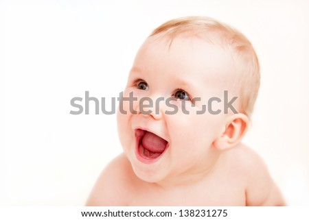 Cute happy baby laughing. Portrait of the boy on white background - stock photo