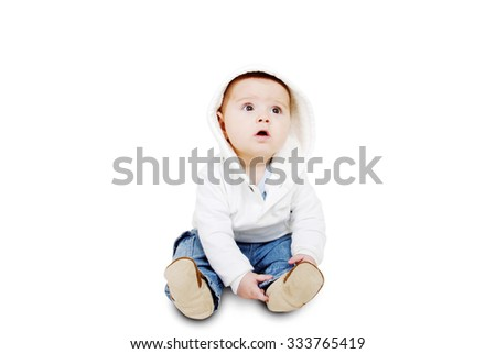 Cute happy baby on the floor on a white background - stock photo