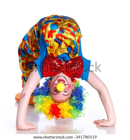 Cute happy boy clown over the white background - stock photo