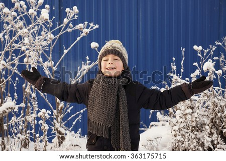 Cute happy boy playing outside.winter time - stock photo