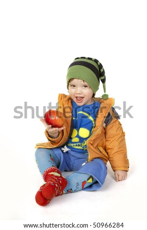 Cute happy child showing his apple - stock photo