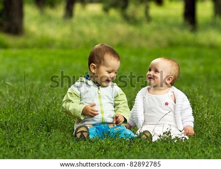 Cute happy children playing in park - stock photo