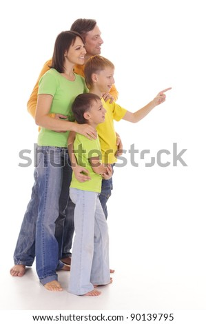 cute happy family posing on a white
