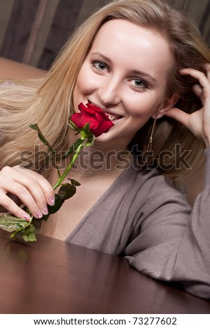 Cute happy girl holding a flower - stock photo