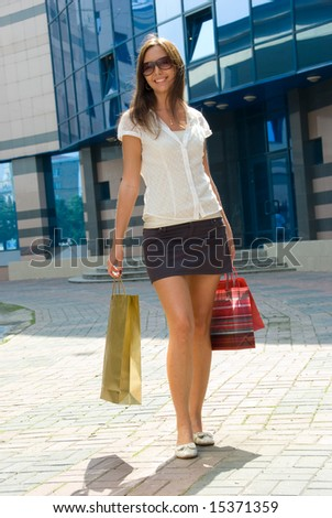 ... street after successful shopping. Mall on the background - stock photo