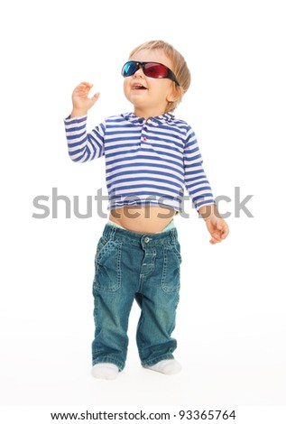 Cute happy kid in 3d glasses walking and looking around - stock photo