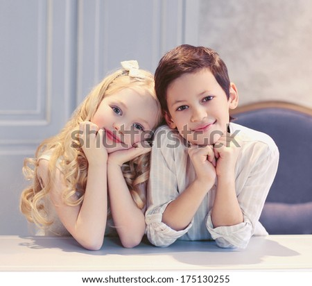 Cute happy kids boy and girl in the room - stock photo