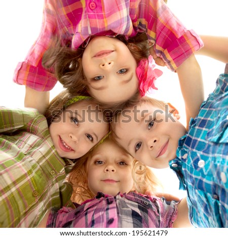 Cute happy kids looking down and holding hands. Happiness, fashionable, friendship concept. Isolated white background. - stock photo