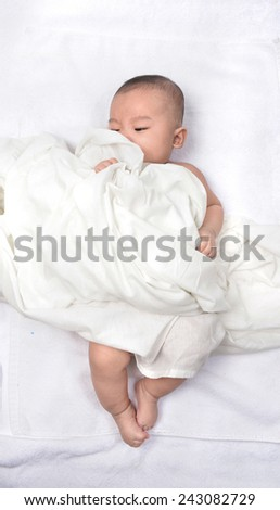 cute happy little baby hidden in white towels - stock photo