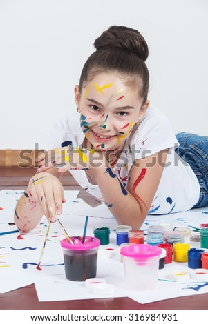 Cute happy little girl, adorable preschooler, painting. Creative young artist at work - stock photo