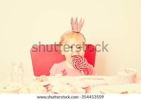 cute happy little princess at pink girls party - stock photo