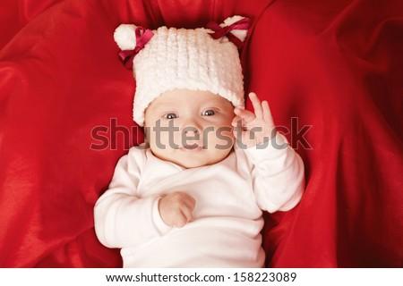 cute happy shows OK gesture - stock photo