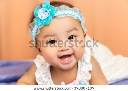 Cute happy smiling Asian baby with teeth from birth  - stock photo