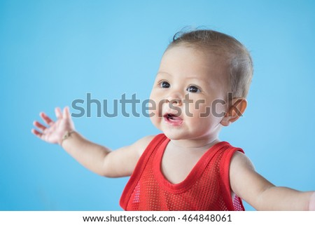 Cute happy smiling baby on blue background. isolated. asia baby.