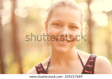 Cute happy teen girl rest on the nature