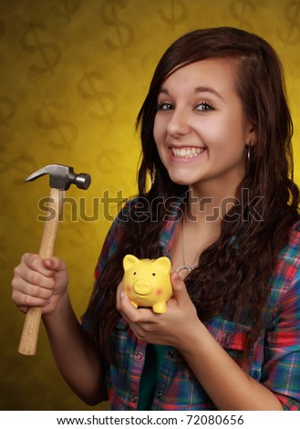 cute happy teenager girl holding a peggy bank and hammer - stock photo