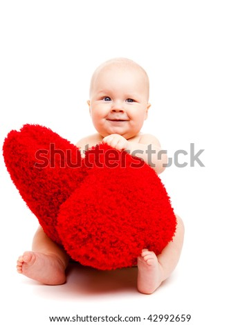 Cute happy valentine baby playing with red hearts - stock photo